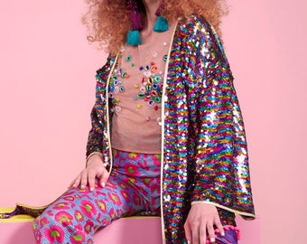 Rainbow Hologram Sequin Kimono with rainbow pom pom trim and purple fringed edge.