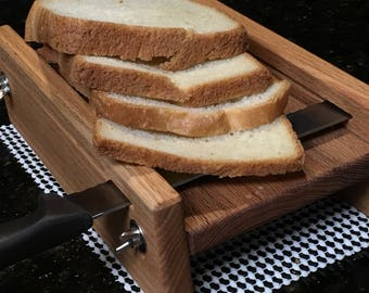 "Horizontal Adjustable Bread Slicing Guide Made of Solid 3/4"" Oak with a Protective Finish Applied.  Includes anti slip mat."