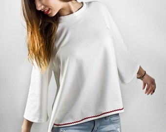 White loose blouse with red detail
