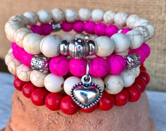 Valentine at heart! Set of 4 stretch bracelets in rustic red, off white and hot pink turquoise beads with puff heart charm. Boho Stackers.