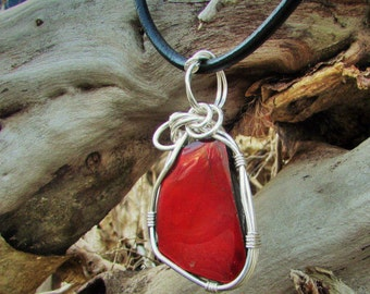 solid red to green ammolite pendant
