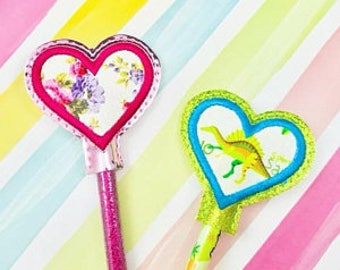 Pencil topper in a heart shape