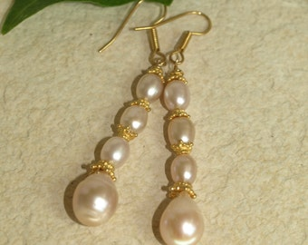 Pretty pink pearls with fancy vermeil spacers on French wire
