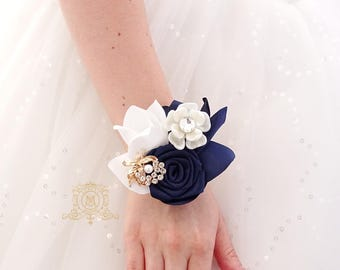 Navy blue gold brooch corsage. Beige cream crystal jeweled bridesmaids, maid of honor, mother of the bride and groom acessory.