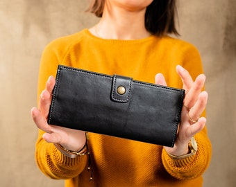 Black leather wallet for women, long women's wallet with snap. Safe long leather wallet for cards and cash with snap closure. Compact wallet