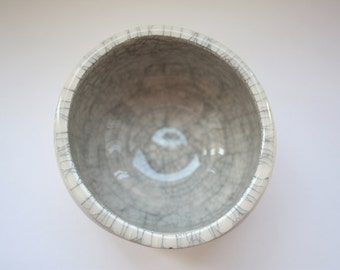 Round bowl. Small earthenware vessel handthrown with an aged look and embossed royal crowns