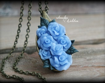 Antique bronze rose necklace with blue blossoms