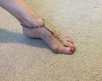 Beaded barefoot sandal in copper, teal and bronze glass beads. Size Sm