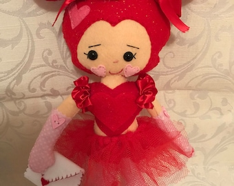 She's all heart! Felt doll
