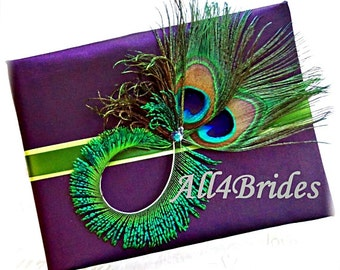 Eggplant purple and green peacock feathers wedding guest book.