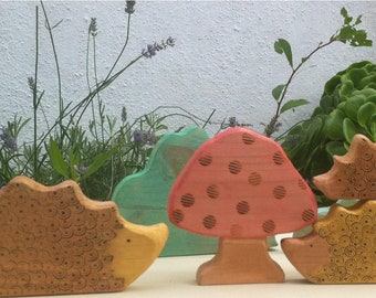 Hedgehog family. Wooden toy.