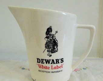 Dewars White Label scotch whisky jug, advertising Wade Regicor in London