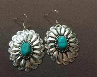 Silver Earrings with a Turquoise stone set in the center