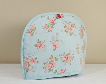 Tea cosy in sky blue with pink flower design