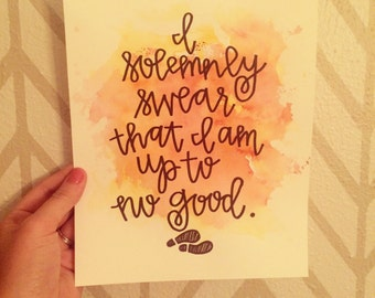 I solemnly swear that I am up to no good. Harry Potter hand lettered quote with watercolor background.
