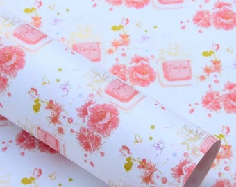 Gorgeous, luxury gift wrap in a pink perfume and flower design per sheet.