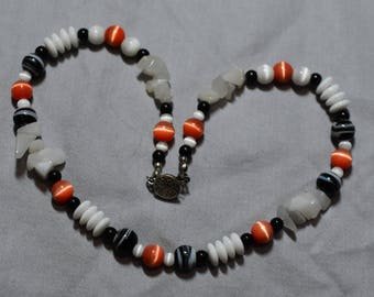 Coral and white catsye and black swirl beads
