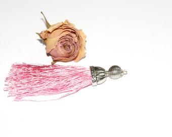 Approximately 13 cm x 2 cm cotton tassel.