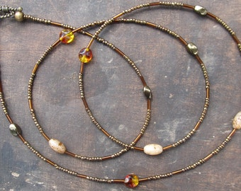 BRONZE AGE custom made waist beads, seed beads, bird little eggs, bronze twisted beads, diamond cut  beads, read item details and leave size