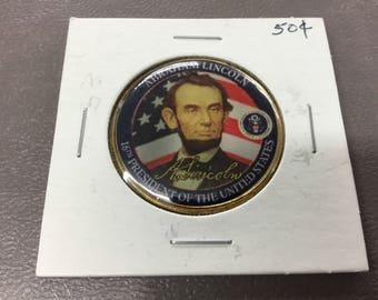 Abraham Lincoln colored half dollar