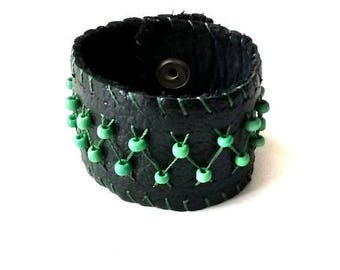 Leather bracelet. Handmade and hand-woven bracelet with accessories