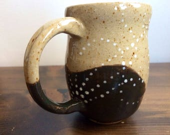Hand painted speckled stoneware mug in black and white design