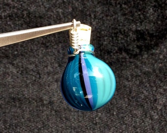 Flame worked blown glass keepsake pendant - blue stripes and sparkles