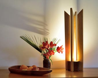 Solid pine and walnut lamp with teak insets.