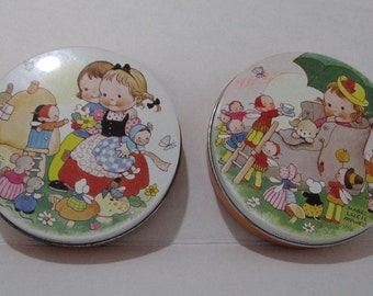Two little Huntley & Palmer Biscuit tins made for children