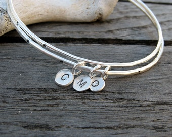 Personalized sterling silver bangle with silver initial tag by VisionQuest