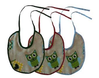 Tre bavaglini handmade con ghufetti e casette