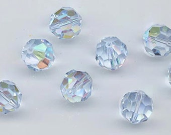 Twelve Swarovski crystals in the non-standard color alexandrite AB - Art. 5000 - 10 mm