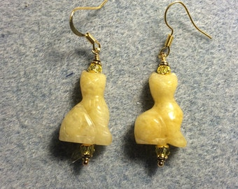 Yellow jadeite gemstone cat bead earrings adorned with yellow Chinese crystal beads.