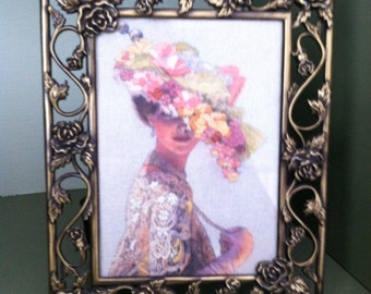 Antique brass frame w embroidery of lady