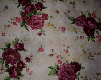White cotton fabric with pick roses and tiny yellow flowers