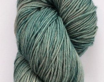 A gorgeous, super soft hand dyed 4 ply yarn in a tonal sea green on a merino, cashmere, nylon base.