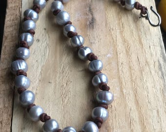Pearl and brown leather knotted necklace