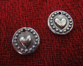 925 sterling silver oxidized charm with a heart