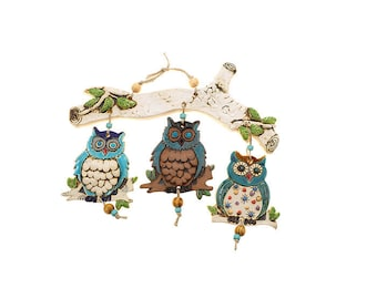 Three owl's Mobile On a wide branch