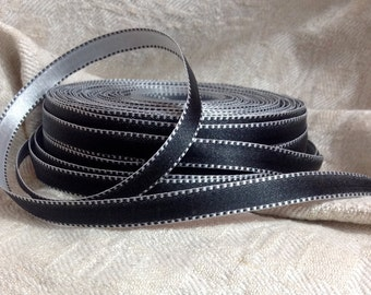 two yards of black and white satin stitched edge ribbon