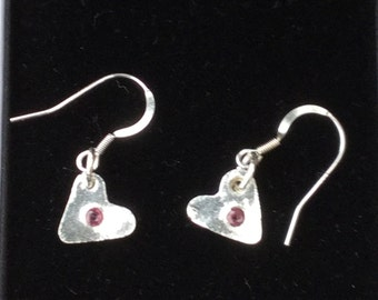 small sterling silver heart earings with a real ruby in both centres