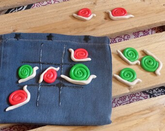 Game of Tic Tac Toe in recycled jeans and pawn paste fimo