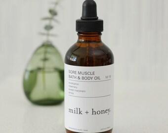 milk + honey Sore Muscle Bath & Body Oil, Eucalyptus, Arnica, Rosemary, Sweet Marjoram 4oz