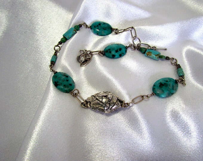 """Item 5087 - """"Nature's Pod"""" Handcrafted, sculpted 999 Fine Silver with Turquoise, 925 Sterling Handcrafted chain, Sesame Jasper and Magnasite"""