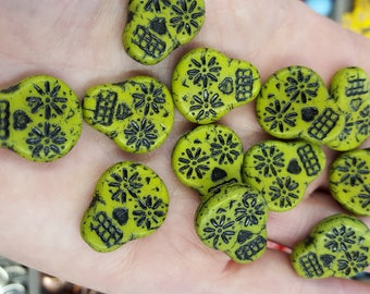 Czech glass sugar skulls. Pea green with black accents, skull beads, 20mm x 16mm. WHOLESALE. Beadwork, Jewelry making, Jewelry supply.