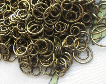 Brass Ox Plated Jump Ring Mix 4-10mm 1 ounce at least 200 pieces