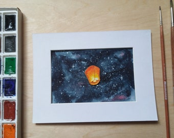 Fire lantern in space. Original watercolor painting.