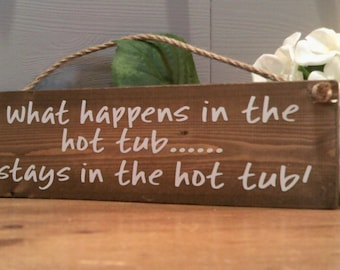What Happens in the Hot Tub..... Hanging Plaque Sign