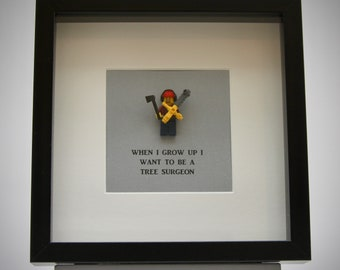 When I grow up I want to be ..........A Tree Surgeon LEGO mini Figure framed picture 25 by 25 cm