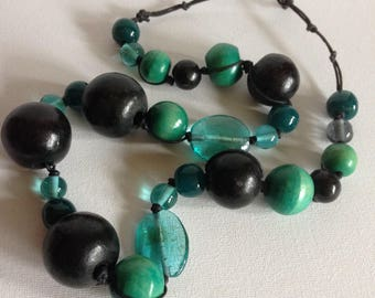 Necklace - Chunky blue and turquoise blue and clear plastic necklace with large wooden beads
